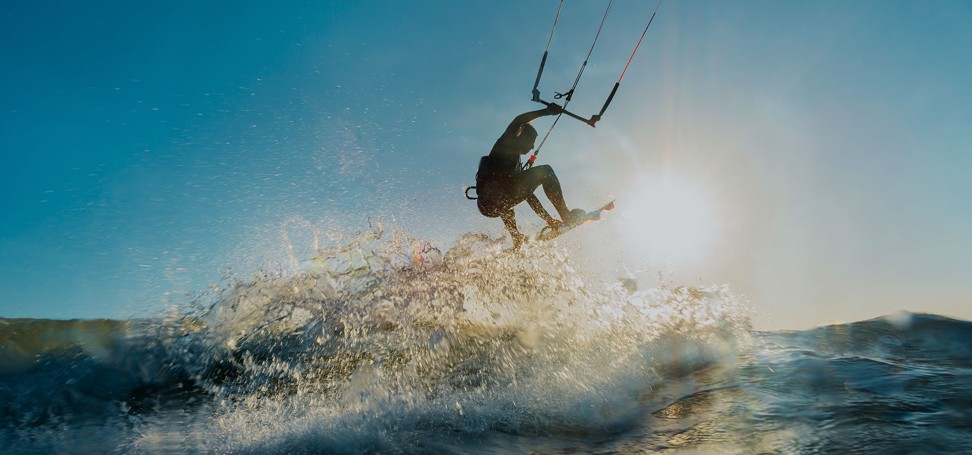 kitesurfer riding waves